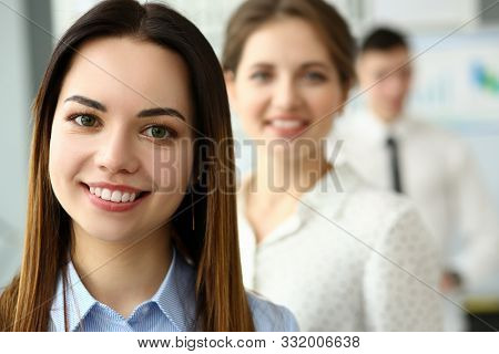 Portrait Of Smart Woman Standing In Big Modern Office Working With Great Friendly Collective And Loo