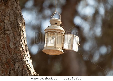 Rosh Haayin, Israel, October 31, 2019 : Decorative Candlestick Hanging On A Tree In A Public Park In