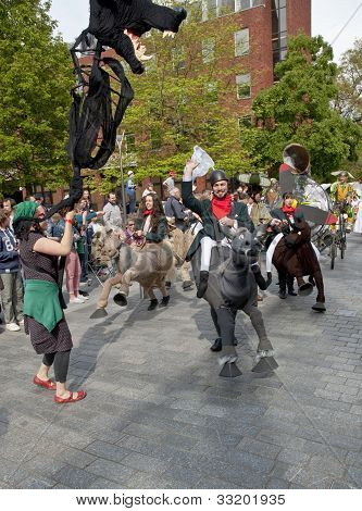 A giant dog costume walks through the streets os Exeter as part of the Battle for the Winds