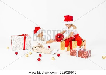 Happy Little Kids In Santa Hat With Christmas Gift Boxes. Isolated On White Background. Sale, Holida