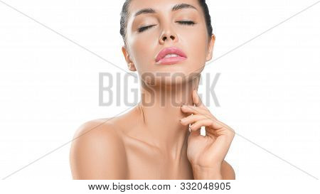 Close Up Portrait Of A Sensual Woman Touching Her Neck Skin. Photo On A White Background. Anti Age A