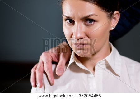 Girl Looks In Disgust While A Man Holds His Hand On Her Shoulder, Close Up