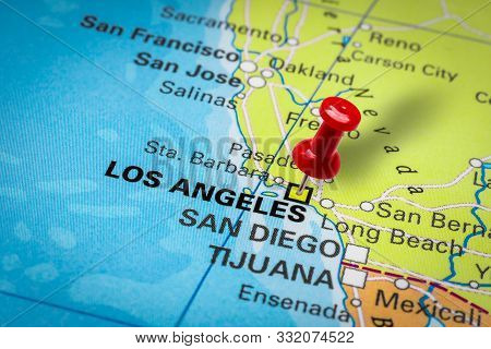 Prague, Czech Republic - October 28, 2019: Red Thumbtack In A Map. Pushpin Pointing At Los Angeles C