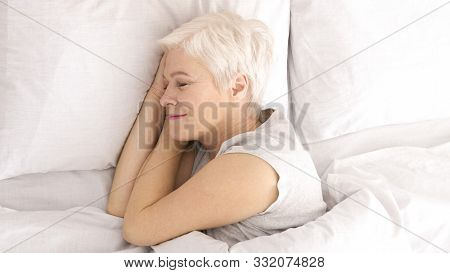Good Sleep. Healthy Senior Woman Napping In Bed, Top View, Panorama