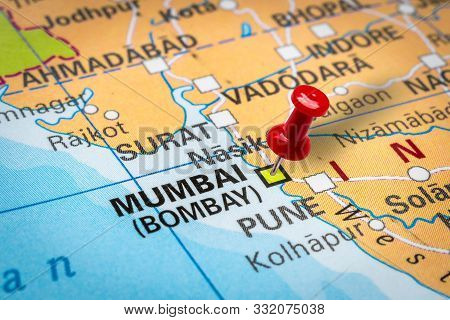 Prague, Czech Republic - October 28, 2019: Red Thumbtack In A Map. Pushpin Pointing At Mumbai (bomba
