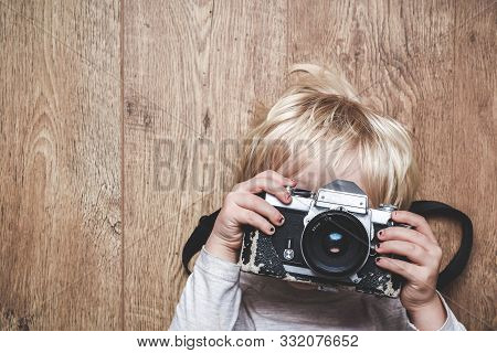 Boy Taking A Photo With A Vintage Camera Learning At Home How To Take A Picture The Child Is Holding