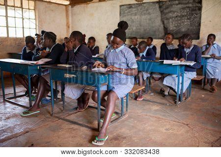 NAIROBI, KENYA-SEPTEMBER 10, 2014: Unidentified girls study in a simple classroom near Nairobi, Kenya.