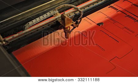 Laser Cutting Beam High Precision On A Paperboard. Modern Machine Industrial Technology Of Paperboar