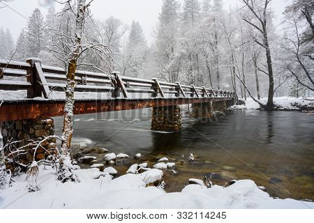 Long Exposure Of Driving Snow And Bridge Over The Merced River