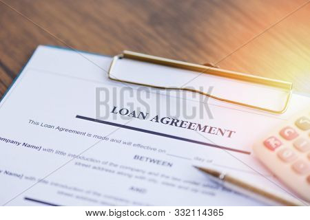 Loan Agreement Application Form With Pen And Calculator On Paper Financial Help / Financial Loan Neg