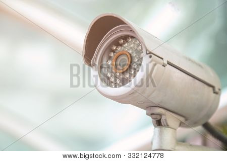 Cctv Cameras Are Installed With Poles In The Parking Lot. Security Cctv Camera Or Surveillance Syste