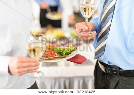 Refreshments at business meeting close-up appetizer plate and wine
