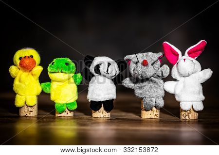 Animal Finger Puppets On Wooden Table, Concept Learning And Theater, Copyspace