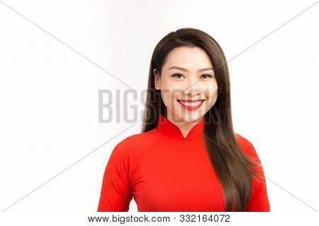 Pretty Asian Woman Wearing A Red Ao Dai Standing Studio Background With Copy Space