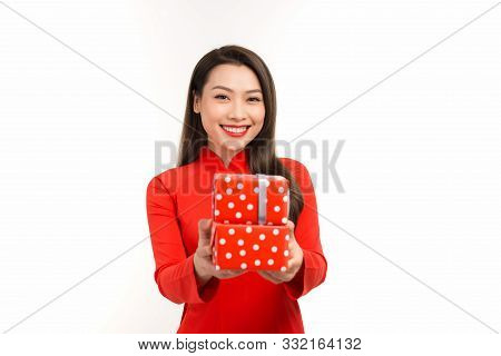 Photo Of Asian Curious Woman In Traditional Ao Dai Rejoicing New Year Gift Box.