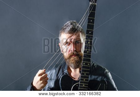 Attractive Man With Guitar. Fashionable Guitarist With Classic Instrument. Music Hobby. Guitar Playe
