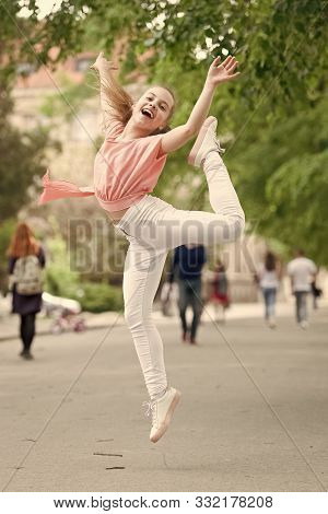 Full Of Energy. Girl Carefree Child. Health, Good Mood And Positive Energy. Energetic Child. Save En