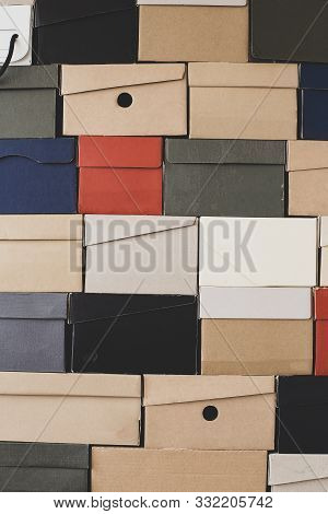 Pile Of Uniformly Folded Shoe Boxes Of Different Colors Can Be Used As A Background Or Wallpaper. Se