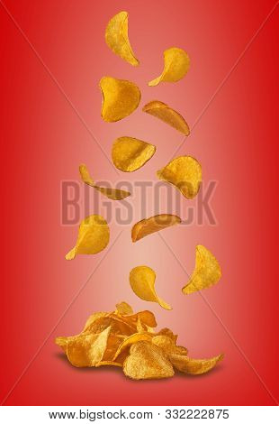 Potato Crisps Falling Down Against A Red Background With Copy Space For Text Or Images. Crispy, Pala