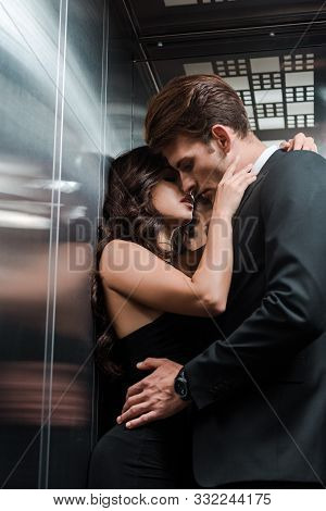 Beautiful Seductive Couple Hugging And Kissing In Lift