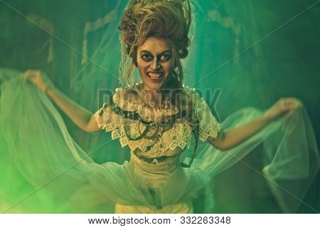 Evil dead empress in the old abandoned castle. Ghost in the castle. Vintage style. Halloween.