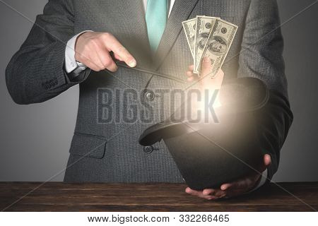 Magician Is Casting A Magic Spell And Get Money From His Bowler Hat.