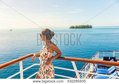 Cruise ship travel vacation woman looking at ocean from deck of sailing boat. Luxury Tahiti Bora Bora French Polynesia destination summer lifestyle.