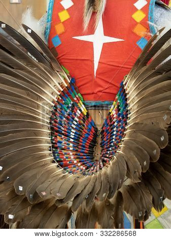 Close Up Of A Feather Bustle Worn By A Native American Fancy Dancer At A Pow Wow.