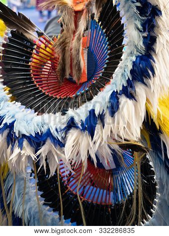 Close Up Of White, Light Blue And Royal Blue Feathered Headdress And Bustle Worn By A Native America