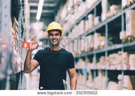 Smart Indian Engineer Man Worker Wearing Safety Helmet Doing Stocktaking Of Product Management In Ca