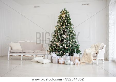 Classic Christmas New Year Decorated Interior Room New Year Tree. Christmas Tree With Gold Decoratio