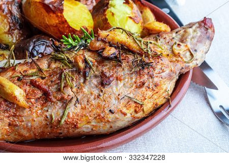 Delicious And Appetizing Roasted Pork Tenderloin With Spices And Potatoes (black Pepper, Olive Oil,