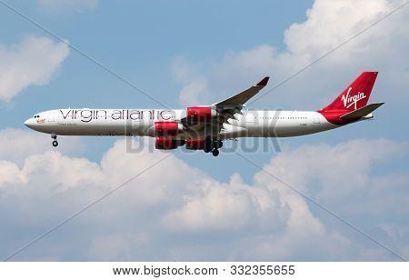 London / United Kingdom - July 14, 2018: Virgin Atlantic Airbus A340-600 G-vred Passenger Plane Land