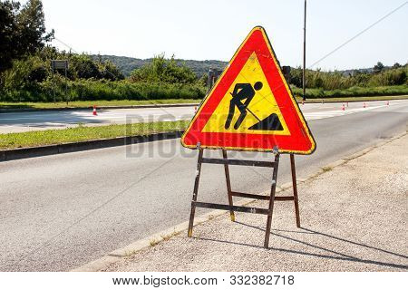 Road Works Sign For Construction Works In City Street. Road Under Construction Traffic Sign. Traffic