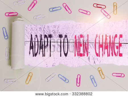 Word writing text Adapt To New Change. Business concept for Get Used to Latest Mindset and Behavior Innovation Paper clip and torn cardboard placed above a wooden classic table backdrop. poster