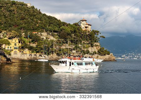 Portofino, Liguria, Italy - Dec 9, 2016: A Group Of Tourists Is Arriving On A Ferry In The Port Of T