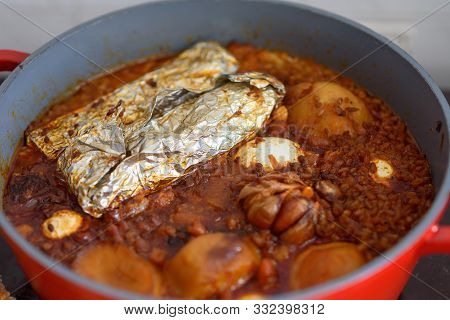 Hot Plate For The Sabbath, A Pot Of Spicy Meat Cooked With Potatoes, Barleys, Jachnun, Wheat And Egg