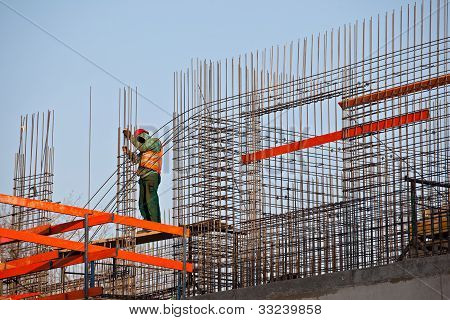 Worker Prepearing Concrete Bars