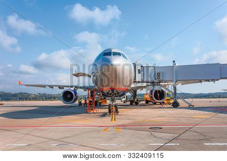 Airplane With Boarding Stairs, Waiting For Boarding Passengers And Baggage Before The Flight, Airpor