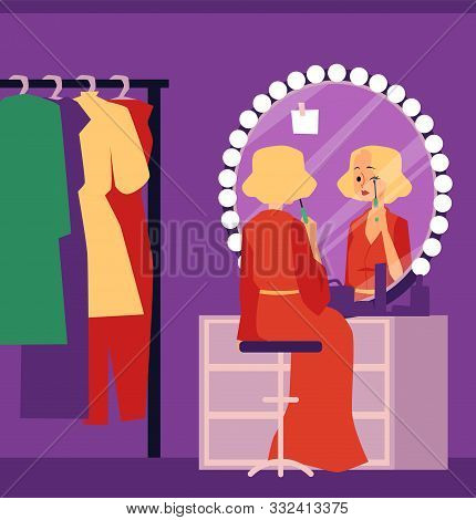 Theater Actress In Dressing Room Applying Makeup Sitting By Vanity Mirror
