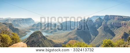 Panorama Of The Blyderivierspoort Dam And The Three Rondavels In The Blyde River Canyon As Seen From
