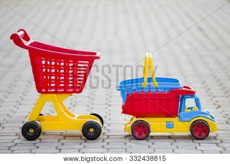 Bright Plastic Colorful Toys For Children Outdoors On Sunny Summer Day. Car Truck, Basket And Shoppi
