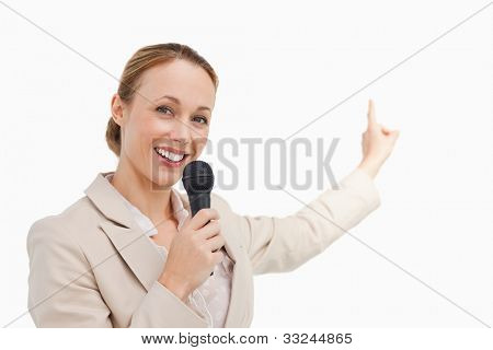 Portrait of a businesswoman in conference against white background