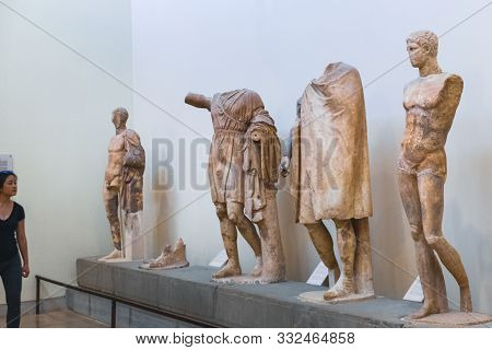 Delphi, Greece - September 21, 2017: Tourist Visiting Archaeological Museum In Delphi Greece