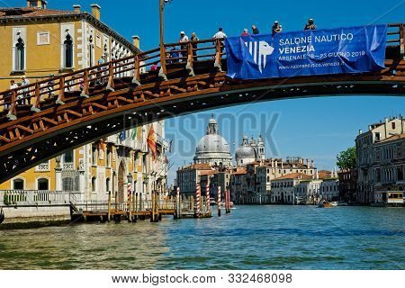 Venice, Italy - June 2, 2019: Tourists Take In The View From The Ponte Dell Accademia Over The Grand