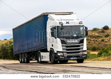 Occitanie, France - September 10, 2019: White Semi-trailer Truck Scania R450 At The Interurban Road.