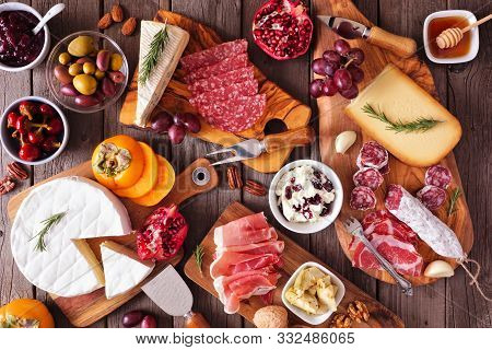 Charcuterie Boards Of Assorted Cheeses, Meats And Appetizers. Above View Table Scene On A Rustic Woo