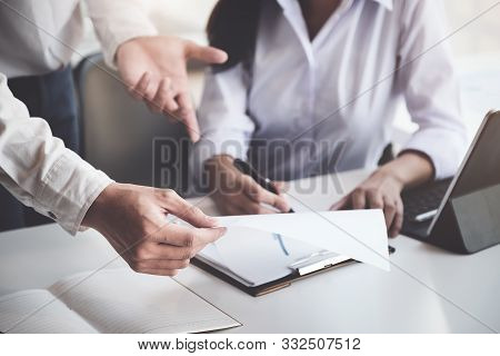 A Male Business Consultant Describes A Marketing Plan To Set Business Strategies For Women Business