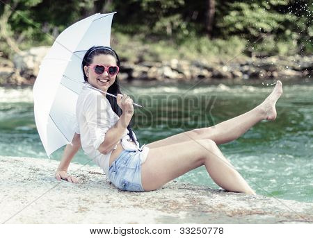 Girl posing by the river