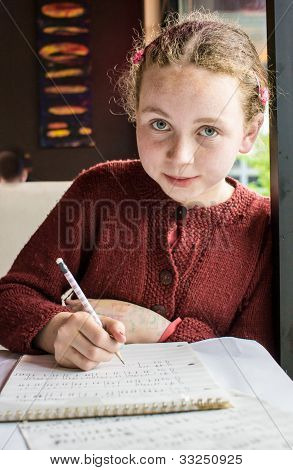 young girl composing music